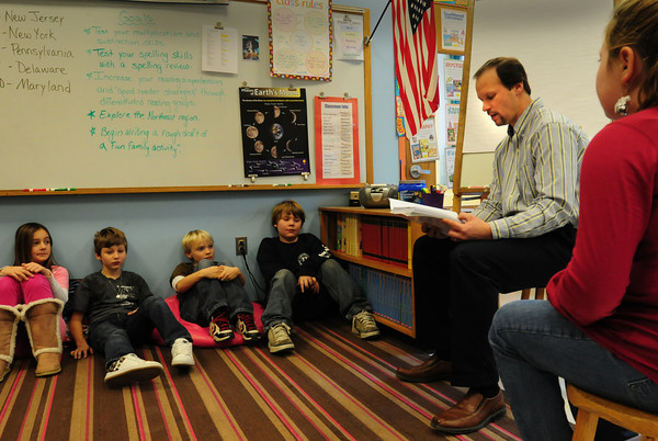 "Newbury: Dr. Troy Carr shares the ending to his new book, ""Trista of Alacar,"" to Marianne McParland's fourth-grade class at Newbury Elementary School on Wednesday. Bryan Eaton/Staff Photo"