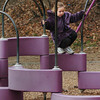 Amesbury: Isabella Fanning, 6, moves around on some playground equipment at Amesbury Elementary School on Tuesday afternoon. She was at the Amesbury Recreation Department's Afterschool Program which went outside before coming in for crafts and games. Bryan Eaton/Staff Photo