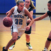 Byfield: Triton's Jen Rock flies past Pentucket defenders Saturday in Byfield. Bryan Eaton/Staff Photo