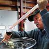 South Hampton: Peter Oldak checks wine just before bottling it at Jewell Towne Vineyards in South Hampton. Bryan Eaton/Staff Photo