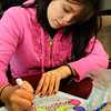 Salisbury: Teen Center coordinator Courtni Welch at the Boys and Girls Club in Salisbury led a small group in some holiday artroom in the center on Tuesday afternoon. Bryan Eaton/Staff Photo