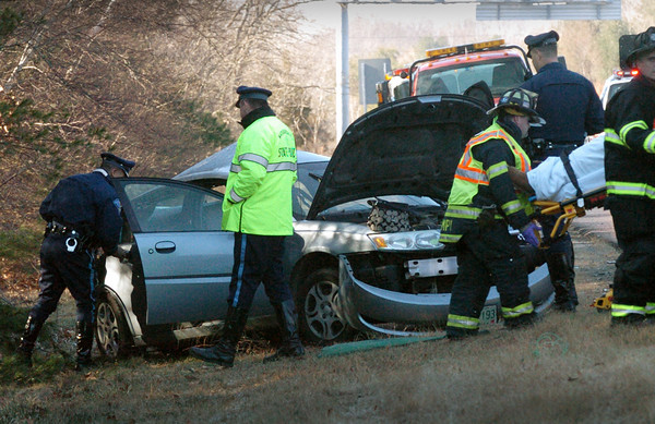 Salisbury: Firefighters remove a Seabrook woman from this crash on Interstate 495 before it merges with 95 yesterday morning. She was airlifted to a Boston hospital after initially being taken to the Anna Jaques Hospital in Newburyport. Bryan Eaton/Staff Photo