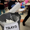 Newbury: Will True, 12, marks down each styrofoam lunch tray getting tossed into the bucket during a waste audit of the Newbury Elementary School Recycling Committe at lunch yesterday, reclycing what products they can and measuring the amount of each. The committee is hoping to reduce the amount of trash generated and is raising funds for a dishwasher and plastice trays to replace the throwaway styrofoam ones. Bryan Eaton/Staff Photo