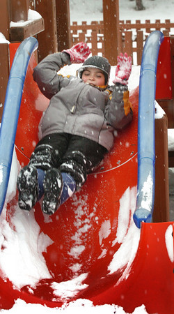 Amesbury: Nearly a foot of snow didn't keep Simon Russell, 10, of Amesbury from having fun on the playground equipment at Amesbury Town Park yesterday afternoon. Bryan Eaton/Staff Photo