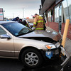 Salisbury: Medical personnel attend to the driver of this car that crashed into this chiropractic business on Bridge Road in Salisbury, then backed up and then hit the guard post. Officials at the scene surmise the victim might have had a medical issue. Bryan Eaton/Staff Photo