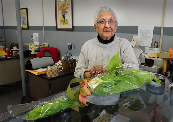 Amesbury: Well-wishers brought Rita Datz a bouquet of flowers as she closed her Maxwell's Jewelers in downtown Amesbury after 56 years of business. Bryan Eaton/Staff Photo