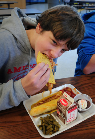 Amesbury: Sage Souther, 13, digs in to one of his spaghetti tacos during lunch at Amesbury Middle School on Thursday. Bryan Eaton/Staff Photo