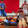 Amesbury: Triton's Darren Lewis looks to pass the ball to teammate Cal Kneeland as Amesbury's Matthew Talbot tries to make the steal. Bryan Eaton/Staff Photo