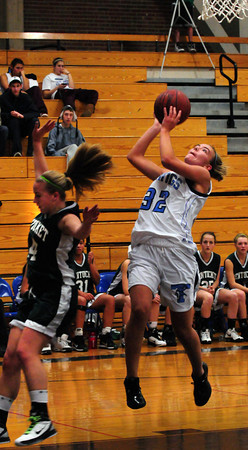 Byfield: Triton's Jen Rock aims for an unsuccesful basket, Pentucket's Nicole Viselli unable to stop the shot. Bryan Eaton/Staff Photo