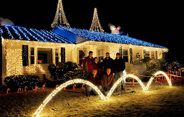 Newburyport: Chris Sheehan has kept a family tradition going by doing a spectacular Christmas display at his Rawson Hill Road home in Newburyport. Pictured, back, from left, Sheehan, wife Emily, with son, Tim,1, friends Garrett Boyd and Nick Notargiacomo who helped along with John Webber, missing from photo. Front is his brother Patrick Sheehan and father TIm. Bryan Eaton/Staff Photo
