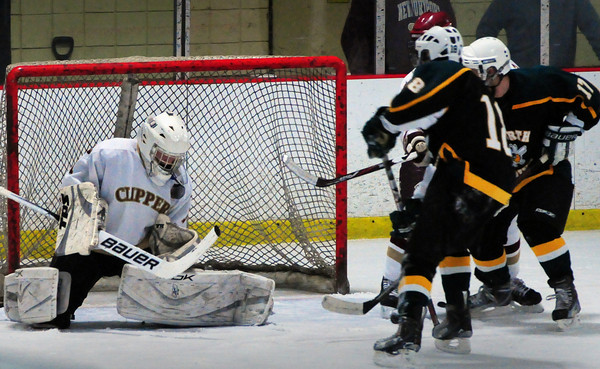 Newburyport: Newburyport goalie Anthony Frederico makes a save on the chest on a shot by North Reading last night at the Graf Rink. Bryan Eaton/Staff Photo