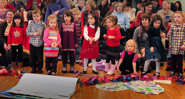 """Newburyport: Youngsters from the Newburyport Montessori School sing """"This Little Light of Mine"""" yesterday morning. They were upstairs at City Hall for their Annual Winter Peace Festival. Bryan Eaton/Staff Photo"""