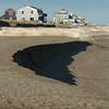 Newbury: Sand dredged from the Merrimack River earlier this season and dumped along Plum Island beach has already been eaten away at Plum Island Center near Jeanne's. Bryan Eaton/Staff Photo