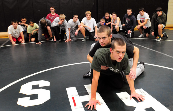 West Newbury: Pentucket wrestlers Tom Funk, front, and brother Jeff with teammates before practice on Friday. Bryan Eaton/Staff Photo