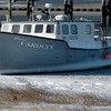 Seabrook: Extreme wind keep fishing boats moored in the harbors and the Sweet Carolyn, surrounded by a layer of ice at the waterline, was no exception in Seabrook Harbor yesterday afternoon. The boat is owned by Ed and Carolyn Eastman which run their namesake fish market at the beach. Bryan Eaton/Staff Photo