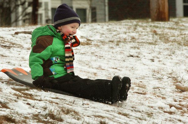 Newburyport: Zachary Markos, 4, of Haverhill smiles as he gets some sledding in at March's Hill for the first time going solo. He was there with his grandmother, Ann McKay of Newburyport. Bryan Eaton/Staff Photo