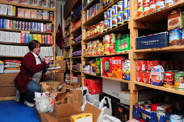 Newburyport: Major Kathy Purvis of the Newburyport Salvation Army sorts food items that were donated to their food pantry. Bryan Eaton/Staff Photo