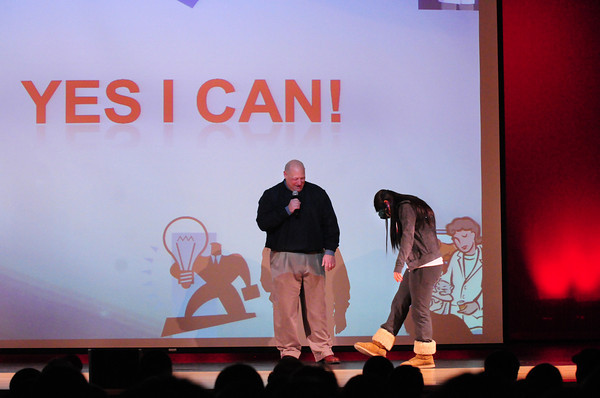 Amesbury: Former police officer Richard Labell put special glasses on student Jenna DeLuca to simulate inebriation during a field sobriety test during a motivational talk at Amesbury High School. Bryan Eaton/Staff Photo