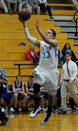 Byfield: Triton's Blaise Whitman goes for two points last night against Danvers. Bryan Eaton/Staff Photo