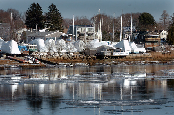Salisbury: Sailboats stored at Ring's Island Marina in Salisbury reflect in the Merrimack River as ice floes head downstream. Bryan Eaton/Staff Photo