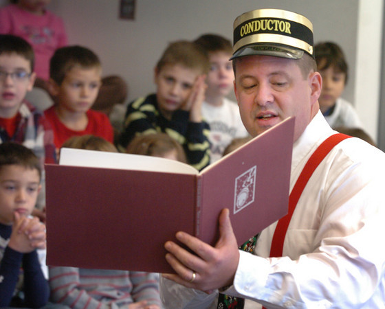 Salisbury: Former Triton School Committee member Jim Poulin donned a conductor's hat as he read the Polar Express to first-graders at Salisbury Elementary School on Tuesday morning. Bryan Eaton/Staff Photo