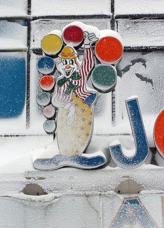 Salisbury: Sticky snow from the blizzard clings to this familiar sign at Joe's Playland at Salisbury Beach on Monday morning. Bryan Eaton/Staff Photo