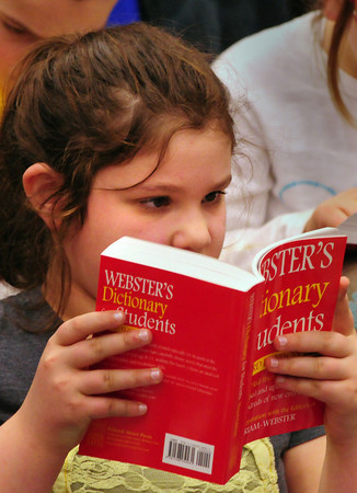 "Amesbury: Skyla Kendall, 9, looks up word ""mayor"" with fellow classmates at the request of Mayor Thatcher Kezer earlier this week at the Cashman School in Amesbury. Kezer and other members of the Rotary Club were on hand to give all third-graders a dictionary. Bryan Eaton/Staff Photo"