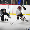 Newburyport: Newburyports Sean Dillon moves past Triton's Zach Vatcher trying unsuccesfully for a goal. Bryan Eaton/Staff Photo