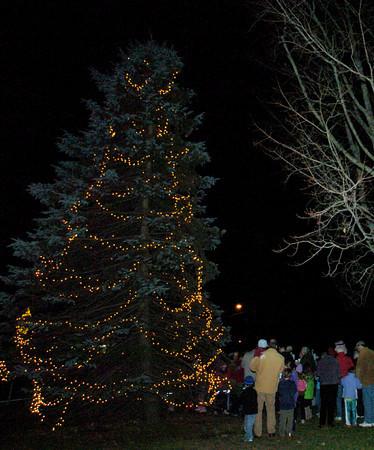West Newbury: Residents sing carols after the light of West Newbury's Christmas tree at the Training Field last night. Bryan Eaton/Staff Photo