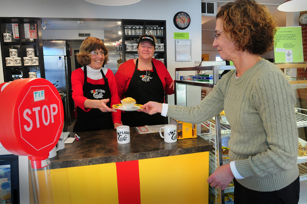 Newburyport: Open only two weeks and Deanna Burke, right, is already a regular at the Stoplight Cafe on Middle Street, here with Denise Maloney, left, and owner Sharon Tripp. Bryan Eaton/Staff Photo