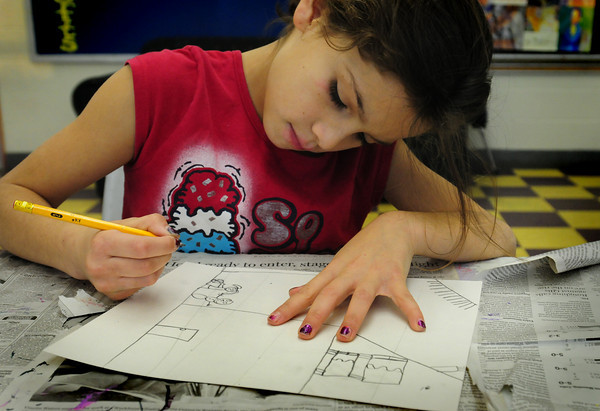 "Salisbury: Aneesa Baez, 8, works on her photo of a winter scene outside her home in a ""view from the window"" in the art room at the Boys and Girls Club. She and others were taking lessons from the club's new art instructor Carolyn Parsons. Bryan Eaton/Staff Photo"