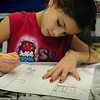 """Salisbury: Aneesa Baez, 8, works on her photo of a winter scene outside her home in a """"view from the window"""" in the art room at the Boys and Girls Club. She and others were taking lessons from the club's new art instructor Carolyn Parsons. Bryan Eaton/Staff Photo"""