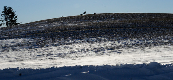 Amesbury: The hill at Woodsom Farm was a little bare of snow from the recent blizzard as the winds blew the snow into drifts, though some were sledding on the west side. Bryan Eaton/Staff Photo