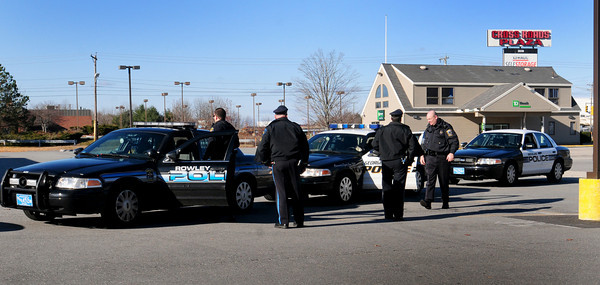 Salisbury: Area police converged in the parking lot of Cinemagic at Cross Roads Plaza in Salisbury yesterday morning in a drill of a hostage situation. Bryan Eaton/Staff Photo