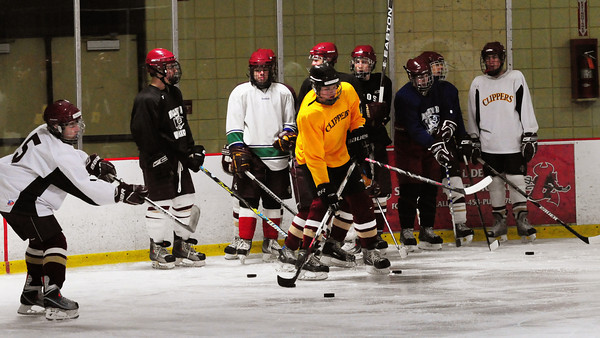 Newburyport: Newburyport High hockey team go through drillls as they started practice last night at the Graf Rink. Bryan Eaton/Staff Photo