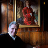 Newburyport: Grog founder Richard Simkins under a portrait of the restaurant's namesake. Bryan Eaton/Staff Photo