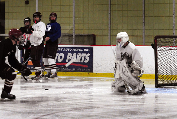 Newburyport: Newburyport High School hockey team started practice last night at the Graf Rink, switching potential goalies as teammate took shots on the net. Bryan Eaton/Staff Photo
