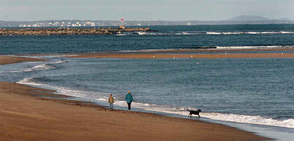 Plum Island: Though the wind was strong yesterday, there were pockets of people walking the beaches of Plum Island. Mount Agamenticus in Maine can be seen in the upper right side of photo. Bryan Eaton/Staff Photo