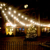 A  Christmas Tree and strings of lights replace outdoor seating at Not Your Average Joe's at the Firehouse in Newburyport. Jim Vaiknoras/Staff photo