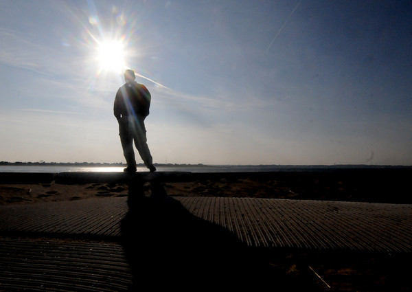 Salisbury : Sam Martini of Haverhill walks along the seawall in Salisbury on a bright sunny Saturday afternoon. Jim Vaiknoras/Staff photo