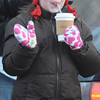 Amesbury: Victoria Demetrio, 9, enjoy a hot cocoa as she waves to the floats in the annual Santa Parade in Amesbury Saturday. Jim Vaiknoras/Staff photo