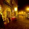 Newburyport:  Lights along State Street in Newburyport illuminate the sidewalk at A Partridge in a Bear Tree . Jim vaiknoras/Staff photo