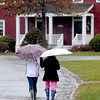 Newbury: Two students brave the rain Sunday as the walk through the campus at The Governors Academy in Newbury. Jim Vaiknoras/Staff photo