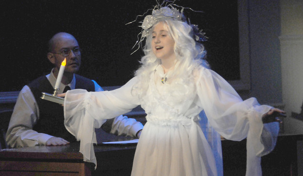 """Newbury: Michelle Martins as the Ghost of Christmas Past and 4th grade teacher David Williams as Scrooge during a dress rehearsal at the Newbury Elementary School for """"The Woodbridge Carol,"""" a play that blends """"A Christmas Carol"""" and Newbury's 375th anniversary this year. Jim Vaiknoras/Staff photo"""