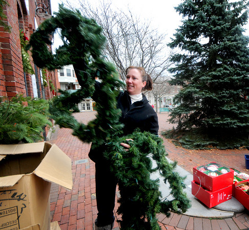 Amesbury: Stefanie McCowan takes strands of garland out of boxes to be used to decorate downtown Amesbury. Jim Vaiknoras/Staff photo