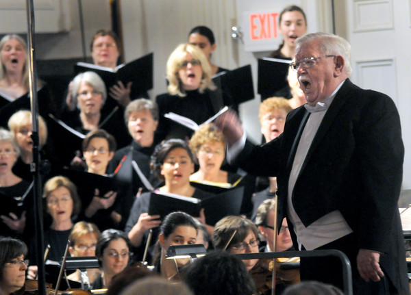 "Newburyport: Musical Director Gerald Weale conducts the Newburyport Choral Society, as well as the audience, in ""Hark! The Herald Angels Sing"" at the annual concert at the Belleville Church in Newburyport Sunday. Jim Vaiknoras/Staff photo"