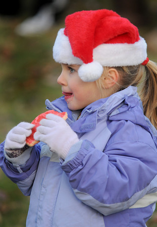 Newbury:Anna Webb, 4,  enjoys hot cocoa and a cookie as she waits for Santa at the annual tree lighting on the Upper Green in Newbury Sunday afternoon. Jim Vaiknoras/Staff photo