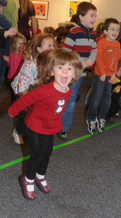 Newbury: Charlotte Hergel, 3, dances to the music of The Toe Jam Puppet Band as they perform at the Newbury Library Saturday morning. Jim Vaiknoras/Staff photo