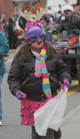 Merrimac: Jasmine Jamaous of Jr Girl Scout Troop 231 gives out candy at the annual Merrimac Santa Parade. Jim Vaiknoras/Staff photo