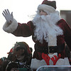 Amesbury: St Nick waves to the floats in the annual Santa Parade in Amesbury Saturday. Jim Vaiknoras/Staff photo
